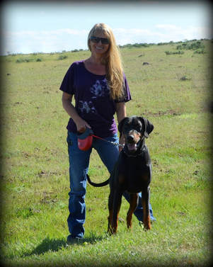 Picture of blond woman with doberman